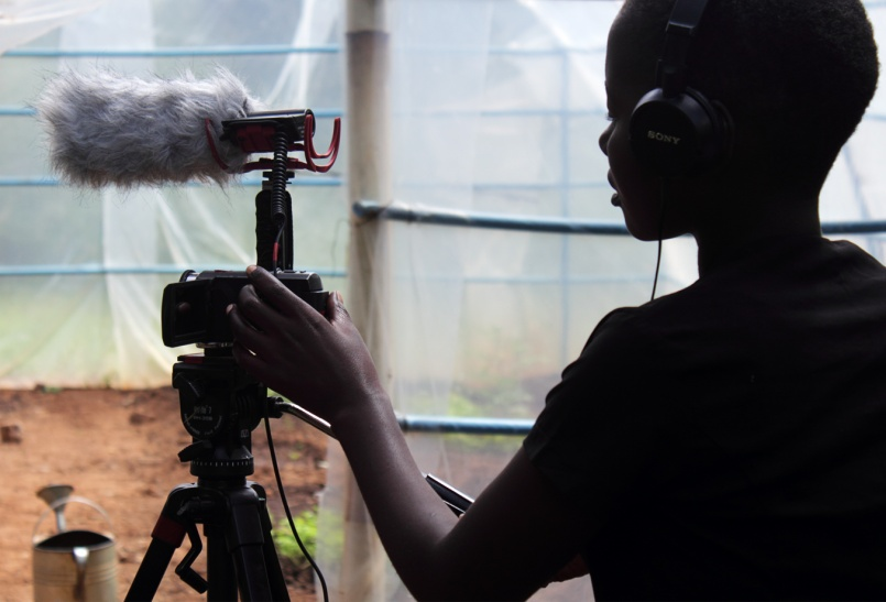 Fanny filming at Kusamala greenhouse